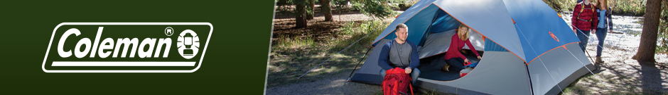 coleman - a family camping in the woods using a large blue coleman tent